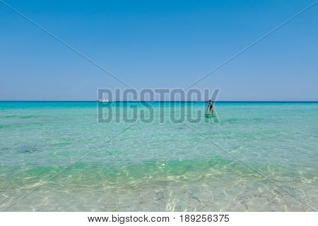 Crystal clear sea water texture with glare from the sun