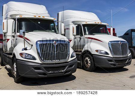 Indianapolis - Circa June 2017: Navistar International Semi Tractor Trailer Trucks Lined up for Sale VII