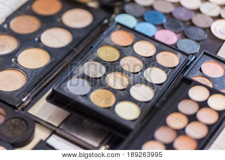 Three palettes of concealer light beige shades for professional make-up.