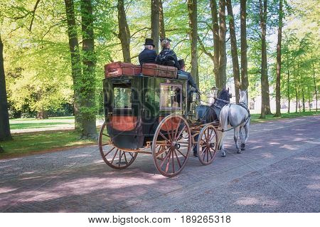 Apeldoorn, The Netherlands, May 8, 2016: Procession of coaches on the lane to the Palace Het Loo in Apeldoorn