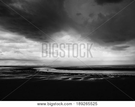 dark clouds and heave storm on a beach in northumbria