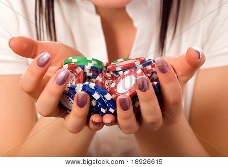 girls hands holding a bunch of poker chips (focus on front)