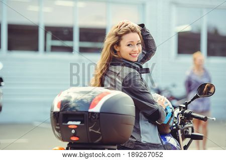 Girl In Moto Equipment With A Motorcycle