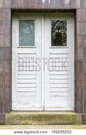 simple old white door with stairs in front
