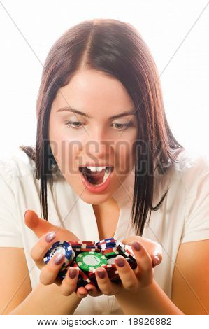 Girls holding a bunch of poker chips (focus on face)
