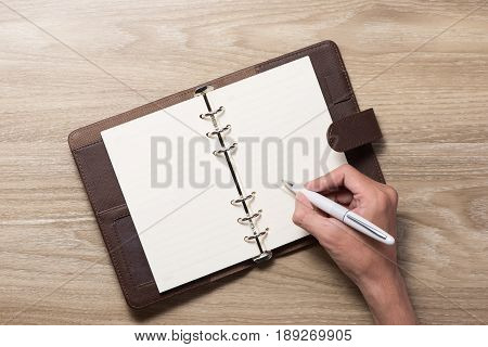 Writting On Blank White Notepad With Right Hand Side