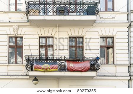 Two Flags Of The Gdr And Ussr On A Balcony In Berlin