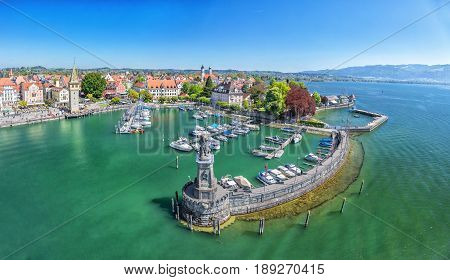 Harbor on Lake Constance with statue of lion at the entrance in Lindau Bavaria Germany