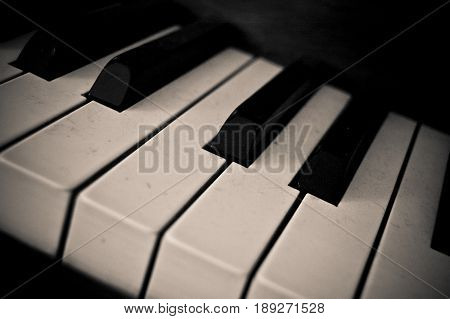 Well-used piano keys, photo in black and white