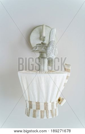 Interior decoration small vintage sconce covered with cloth