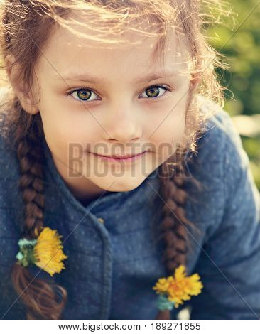 Beautiful Kid Smiling Girl With Braided Hair Style And Big Cute Eyes With Yellow Flowers Outdoors Su