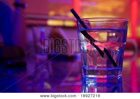 Glass of alcohol drink in the night club