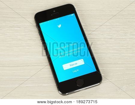 Kiev Ukraine - January 20 2016: Smart phone with Twitter login web page on its screen on wooden background