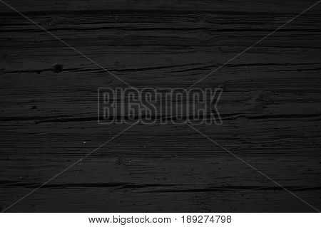 Black wood; a texture and/or background concept