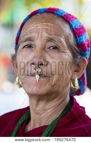 KATHMANDU NEPAL - OCTOBER 23 2016 : Portrait old women in traditional dress in street Kathmandu Nepal
