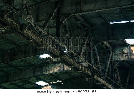 Part of old abandoned rusty building dark creepy warehouse dirty and broken.