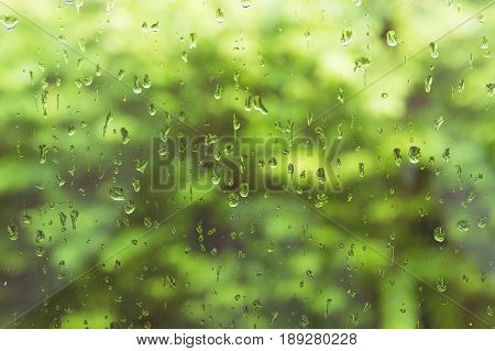 Rain drops on the glass after rain in the mirror background