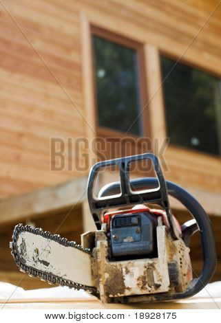 Chainsaw on wood cuttings (Shallow DOF)