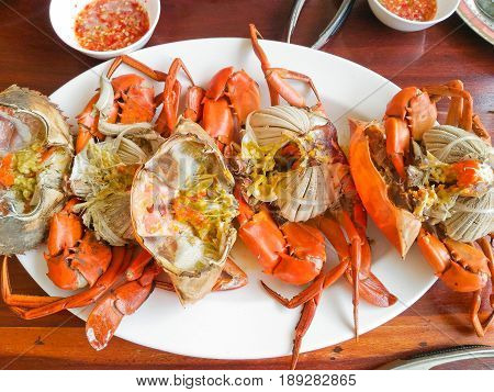 Steamed crabs and crab's spawn with seafood spicy sauce