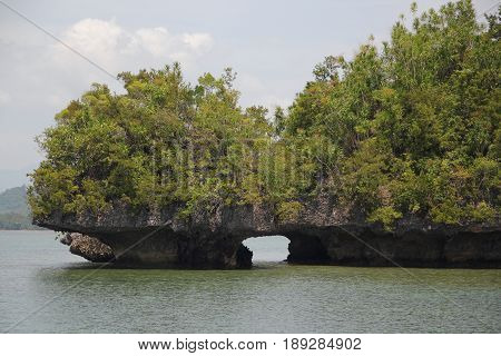 Opening underneath the islands  An artistic cut underneath two rocky islands in Cantilan, Surigao del Sur, Philippines