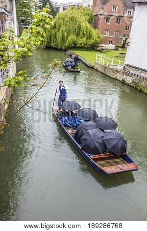 Cambridge UK - APR 16 2017: People enjoying a boat trip at river Cam in Cambridge UK