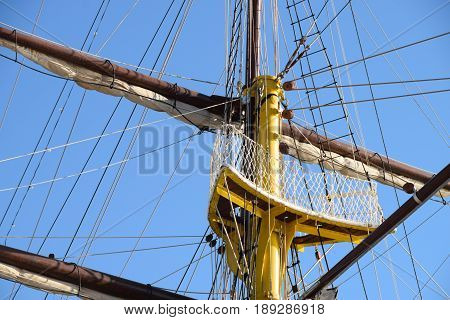 crow's nest and sails on the mast and rope ladders of the old sail boat