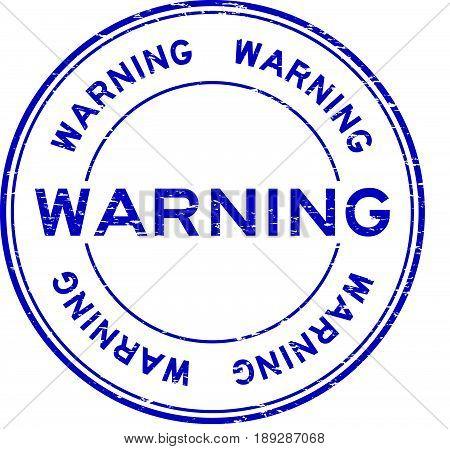 Grunge blue warning rubber seal stamp on white background