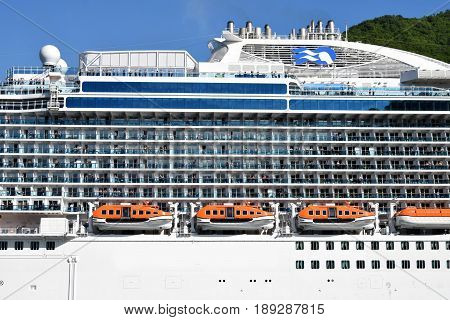 lifeboats on the deck of a large cruise ship