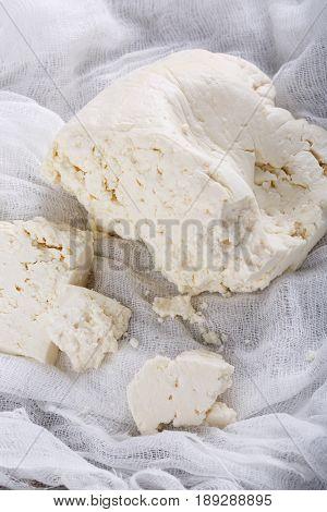 Homemade white brined feta cheese. Dairy products. Raw organic brynza.