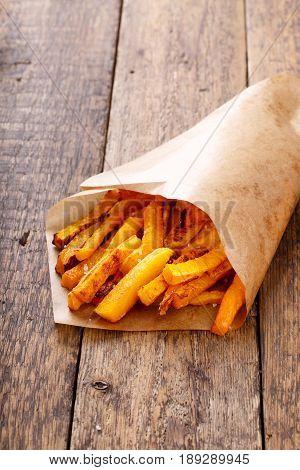 Baked butternut squash fries with sea salt. Pumpkin chips.