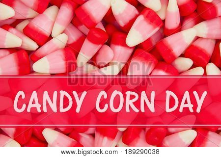 Happy Candy Corn Day message with White pink and red candy corn background