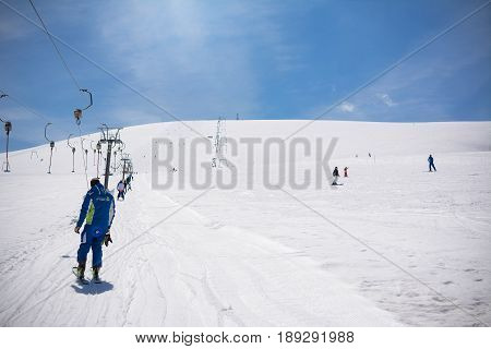 Rapino Italy - April 01 2017: Ski instructor climbs with the ski lift on the ski slopes of Mammarosa Majella in Abruzzo