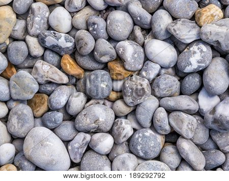 Big pebbles of different colors and sizes.