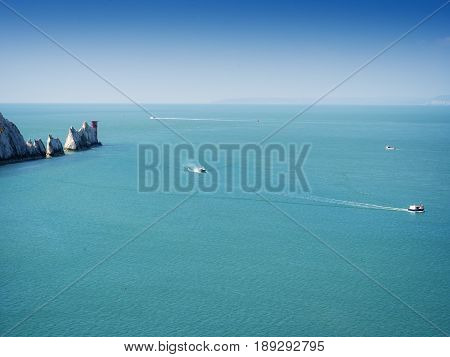 The Needles - is a row of three distinctive stacks of chalk that rise out of the sea off the western extremity of the Isle of Wight UK close to Alum Bay.