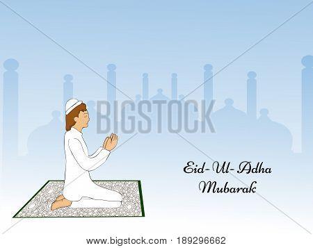illustration of a man praying with Eid Ul Adha Mubarak text