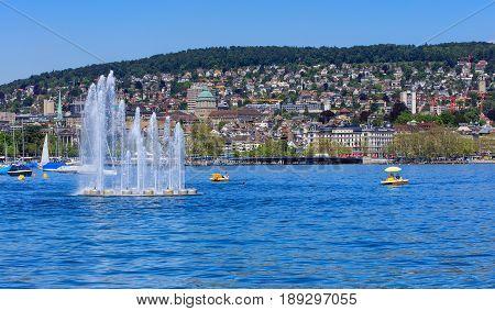 Zurich, Switzerland - 26 May, 2016: Lake Zurich, the city of Zurich in the background. Lake Zurich is a lake in Switzerland, extending southeast of the city of Zurich, which is the largest city in Switzerland.