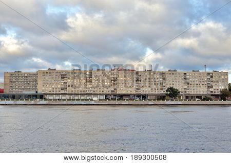Oktyabrskaya Embankment of Neva River at cloud autumn day outskirts of Saint Petersburg Russia.