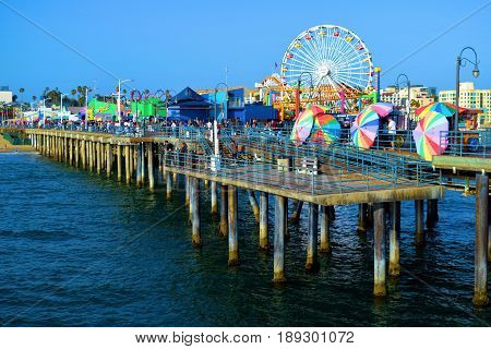 June 1, 2017 in Santa Monica, CA:  Amusement Park with rides on the historic Santa Monica Pier built in 1909 where the public can enjoy restaurants, retail stores, and Amusement Park Rides taken in Santa Monica, CA