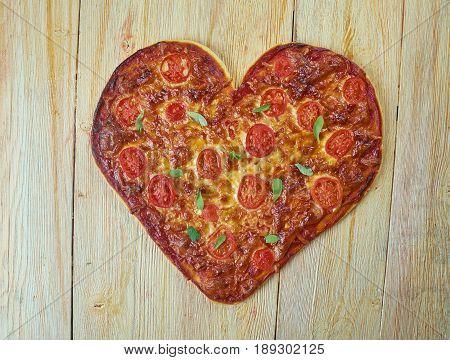 Pizza Margherita - typical Neapolitan pizza made with San Marzano tomatoes mozzarella