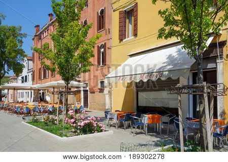 VENICE, ITALY - May 18, 2017. Tourists foot Street in Venice. its entirety is listed as a World Heritage Site, along with its lagoon. VENICE, ITALY.