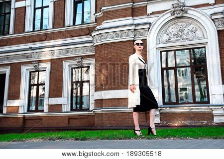 Happy Fashion Blonde European Elegant Woman With Red Lips And White Skin Standing At The Old Red Bri