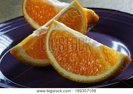 Cut Orange Slices On A Blue Plate