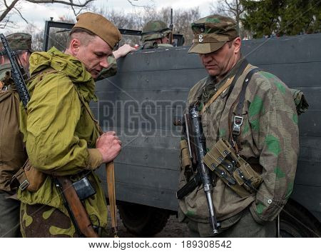 Gatchina, Russia - May 7, 2017: Historical reconstruction of the battles of World War II. The participants of the reconstruction in the form of Soviet and German armies.