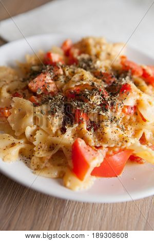 farfalle with tomato and paprika on plate