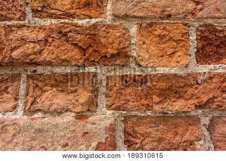 Weathered Texture of Stained Old Brown and Red Brick Wall Background