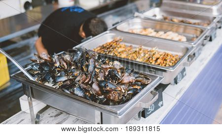 Oysters In The Water Of The Close-up. Sale And Preparation Of Oysters On The Counter. Freshly Caught