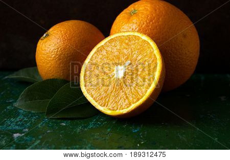 Orange fruit. Orange slices half orange whole orange dark background