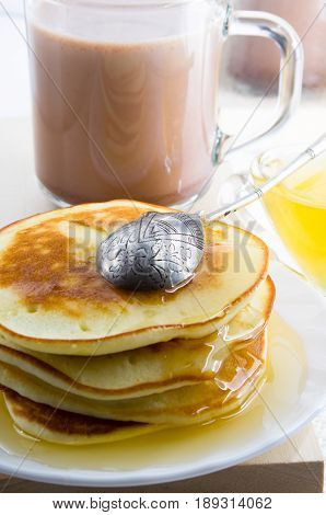 Pancakes With Honey And A Cup Of Hot Cocoa