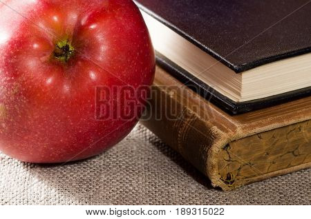 Fragment Of Old Books With Hardcover And Close-up Red Apple