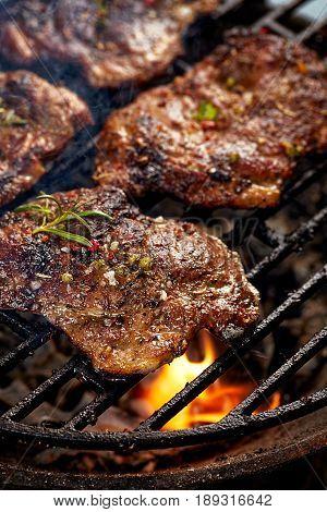 Grilled pork neck fillet steaks on grill plate